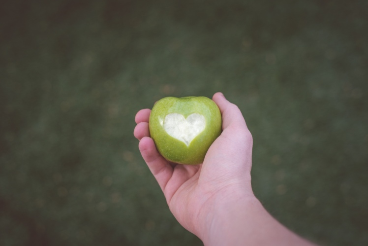 man-holding-green-apple-with-love-heart